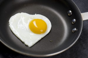 heart-shaped egg in pan