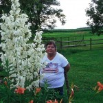 Pat Schmucker, Maximo, Ohio, stands behind her 7 foot tall yucca plant.