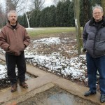 Bernie Gnap (left) and Stephen Kelleher are working to restore and preserve the history of Barberton's Anna Dean Farm. Here, they stand on what remains of O.C. Bardber's mansion, which was torn down in 1965.