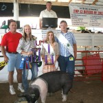 Mackenzie Kiko won the outstanding youth project in the hog division, and was showman of showmen. Her 290-pound hog sold for $7 a pound to Paris Washington Insurance, represented by Kelly Palmer.