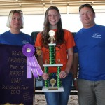 Sarah Kline sold her grand champion pen of market quail for $200 to Darrell and Angela Langford of Sunrise Springs Water Co.