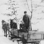 (Submitted by Gary Hemphill  This photo shows Roy Cooper with a precious winter cargo of two little girls. The older girl is Alice Hoover, and peeking over her shoulder is her little sister Grace. Gary Hemphill, Alice Hoover's son, submitted the photo, which was taken in 1925, in Butler County, Pa.