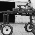 (Submitted by Ray Burger)   Ray Burger of Louisville, Ohio, shared this vintage photo of a 4x4 hydrostatic drive High Boy crop sprayer and corn tassel cutter, c. 1949 or 1950.