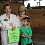 Ashley Robertson garnered $200 for her pen of reserve champion rabbits, purchased by the Wotociec family. Pictured with Ashley are Marilyn and Dylan Wotociec.