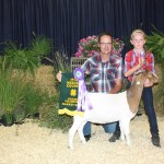 Cool Springs Corn Maze, represented by John McCullough, paid $8 a pound for Josie Gadsby's 86-pound grand champion goat.
