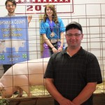 Taylor Edelman's 272-pound grand champion hog drew a bid of $5.60 a pound from Mike Oviatt of Thorne's Bilo Supermarket.