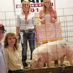 Jeff and Marsha Horne bid $3.50 a pound for Chris Futty's (upper left) 273-pound reserve champion market hog.