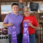Jay Chaddock's 215-pound grand champion hog carcass was sold to Green Lines Transportation for $12 a pound.  Pictured with Jay Craddock is Jean Wackerly of Green Lines Transportation.