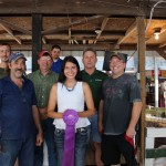Tatianna Varner sold her 129-pound grand champion lamb carcass for $16 a pound to Paris and Washington Insurance, Kiko Meats, Ramsey Hoof Trimming, Village Farmhouse, and Wallace Farms Feed Drive Thru. Representing the buyers are, from left, Steve Kiko, Joe Ramsey, Paul Wallace, Kelly Palmer, and Chris Palmer.