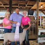 Lindsey Pugh sold her 140-pound reserve champion lamb to Eslich Wrecking for $23 a pound. Pictured from left are Elizabeth Eslich, Richard Eslich, and Lindsey Pugh.