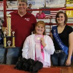 Bailey Poths sold her pen of reserve champion rabbits to Hagan Heating and Plumbing and State Rep. Christina Hagan for $150.  Pictured from left are John Hagan, Bailey Poths, and Junior fair queen Jessica Ruegg.