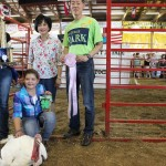 Mykenna Creager's reserve champion turkey was sold to Summit County Probate Judge Dixie Park for $650.  Pictured are Mykenna Creager, Dixie Park, and her husband, Dr. John Park.