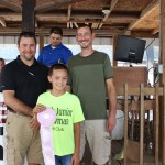 Ryan Ehlers's reserve champion lamb carcass fetched a $10 per pound bid from buyers Miller & Company, Biery Cheese, Beaver Excavating Co., and Johannings Inc. Pictured with Ryan Ehlers is Curtis Bates of Johannings, Inc. and Steve Kiko representing the other buyers.