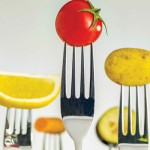 fruits and vegetables on forks