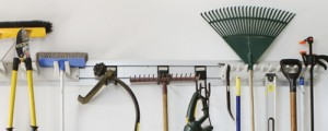 garden tools stored on wall rack