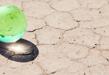 marble globe on parched ground