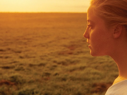 girl and sunset over farmland