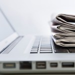 laptop and newspapers