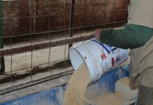 inmate pouring feed