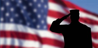 American flag and saluting soldier