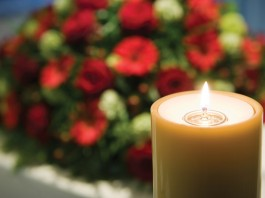 funeral flowers and candle