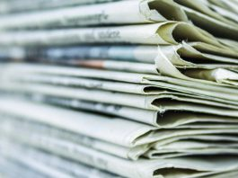 newspaper pile/Susan Crowell column